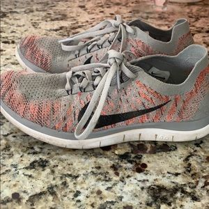 gray and pink nike sneakers